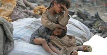 an afghan girl holds her brother as they take a break from searching for items to recycle in kabul july 29, 2006.  reuters/ahmad masood   (afghanistan)